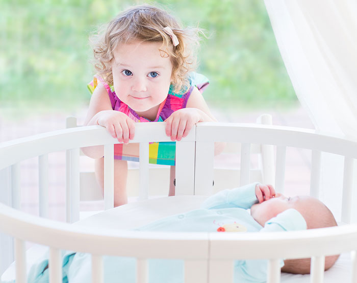 5 ways to ease the transition from a small cot to a big one