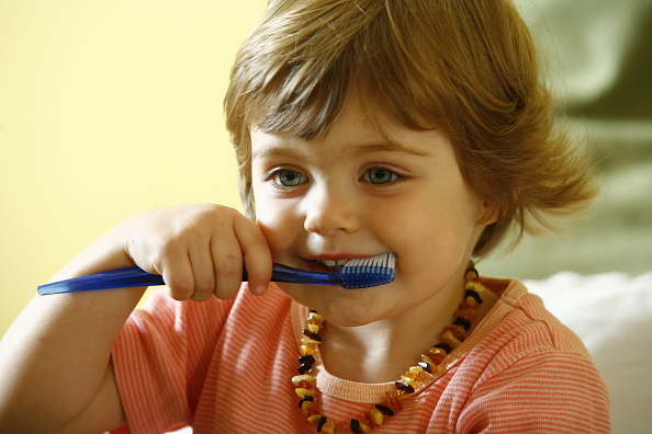 At what age to teach your child to brush their teeth?
